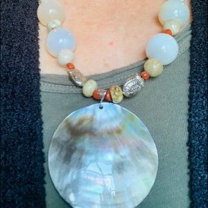 Jewelry - Shell pendant on exquisite marble shaped necklace.